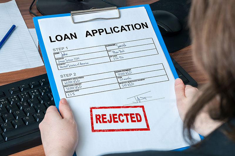 A loan application form that is being rejected.