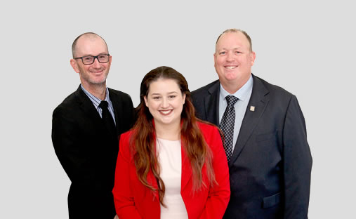 2 men in suits and a lady in red office coat that represents smartline personal mortgage advisers.